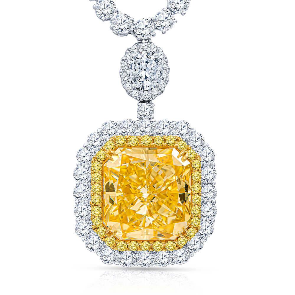yellow and white gold emerald cut canary diamond pendant