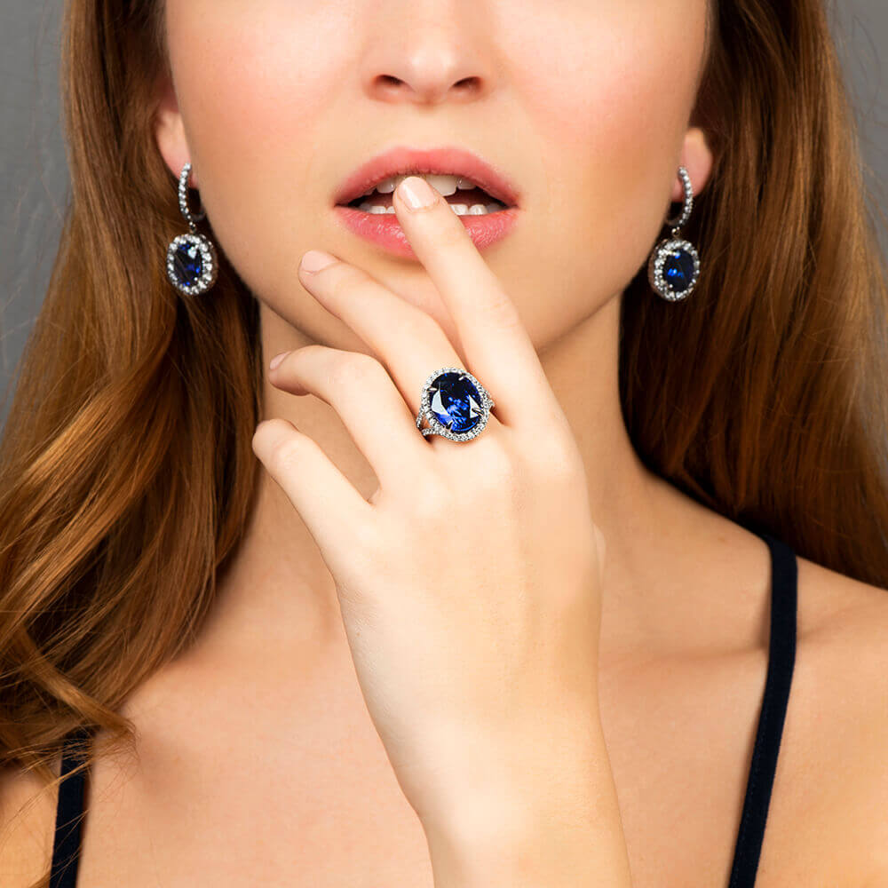 model engagement ring and sapphire earrings