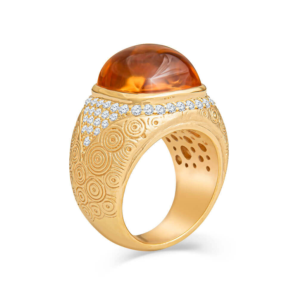 yellow gold ring with gemstone