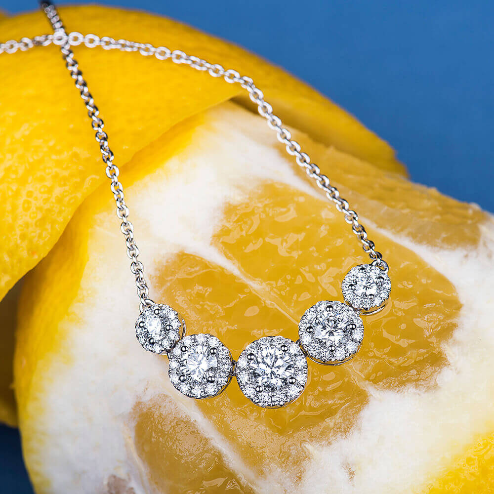 diamond necklace on a lemon